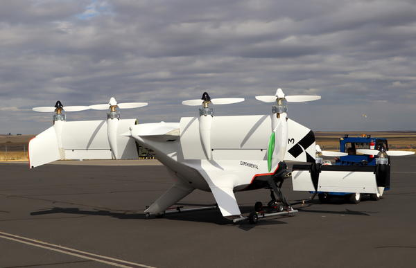 The tilt wings with eight electric motors and propellers in vertical orientation for takeoff and landing.