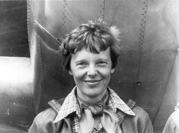 Amelia Earhart stands under the nose of her Lockheed Model 10-E Electra. A USF professor is now involved in the search for Earhart's remains.