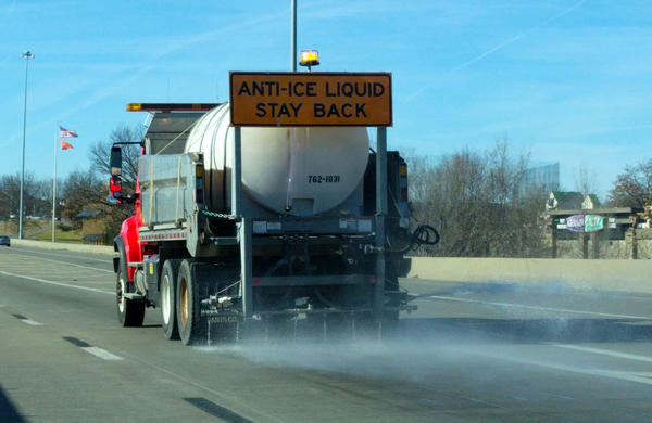 A brining truck sprays saltwater on the roadways ahead of a winter storm in December 2016. Brining can reduce the amount of saltwater runoff from roadways, according to new research from St. Louis University.
