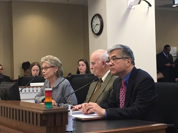 Former Gov. Gary Locke listens as former Gov. Chris Gregoire testifies in favor of I-1000 in April. Sitting between them is former Gov. Dan Evans.