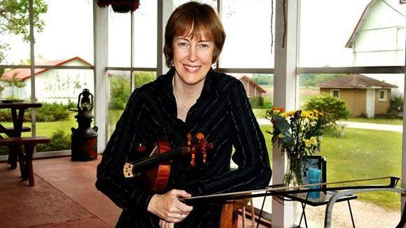 Celtic artist Liz Carroll poses with her fiddle.