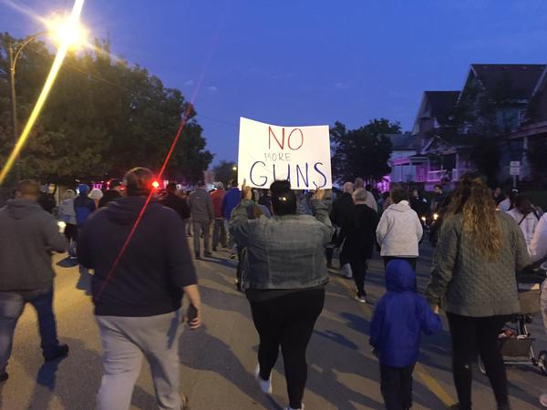 More than a hundred people walked along Central Avenue Monday night to honor the victims of a mass shooting over the weekend. Some called for action on gun control.