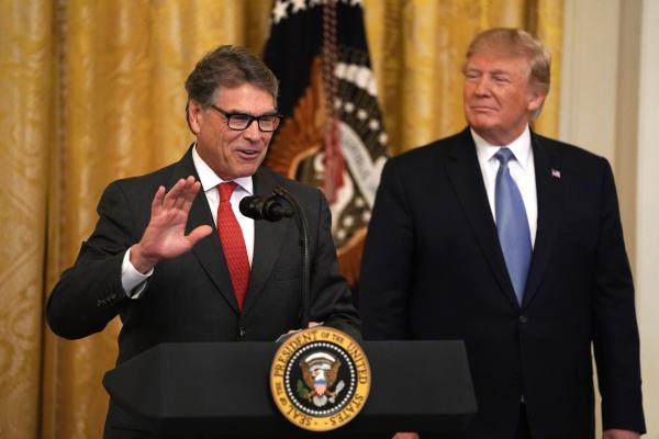 U.S. Secretary of Energy Rick Perry (L) speaks as President Donald Trump (R) looks on during an East Room event on the environment at the White House in Washington, DC.