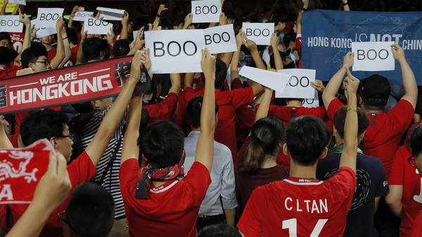 Hong Kong soccer fans protest the Chinese national anthem during a 2022 World Cup qualification game in Hong Kong, Sept. 10, 2019.