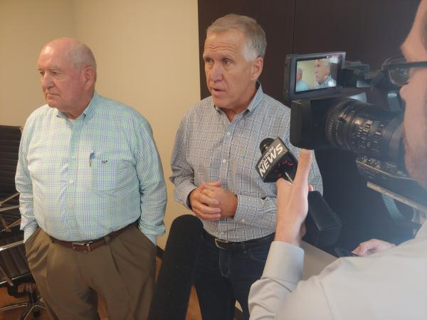 U.S. Secretary of Agriculture Sonny Perdue (left) and NC Senator Thom Tillis speak in Union County on Wednesday.