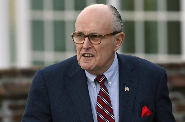 Associates of President Trump's personal lawyer Rudy Giuliani have been arrested on campaign finance charges.