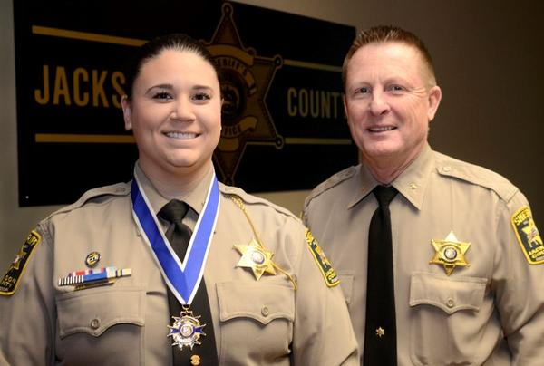 Lauren Michael received a Medal of Valor from then Sheriff Mike Sharp in 2018.