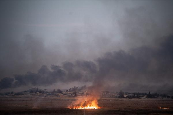 Smoke rises from the Syrian town of Tal Abyad on Thursday on the second day of Turkey's military operation against Kurdish forces. President Trump's decision to pull back U.S. forces from the area has been viewed as giving Turkey a green light for the operation and opened him up to condemnation from within the GOP.