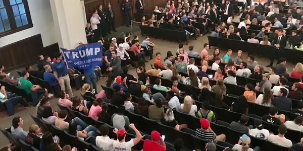 Cheering and clapping ensues when two men begin waving a Trump banner in the aisles of the University Auditorium. MOLLY CHEPENIK/WUFT