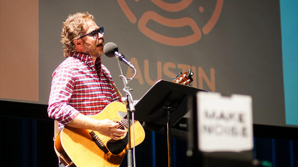 <em>Ask Me Another</em>'s house musician Jonathan Coulton leads a music parody game at Cullen Performance Hall at the University of Houston, in Houston, Texas.