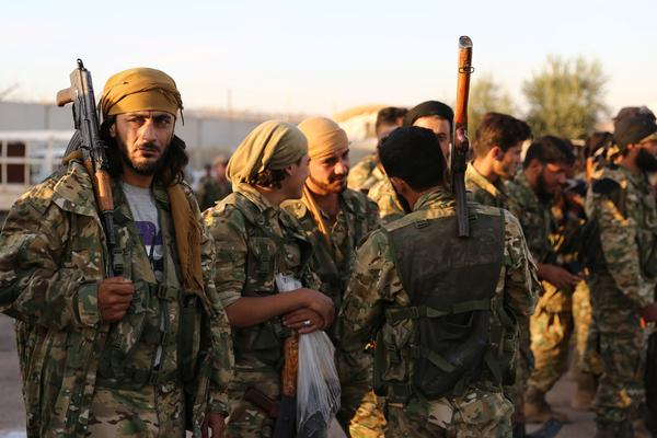 Pro-Turkish Syrian fighters gather near the town of Azaz in Aleppo province as they prepare to take part in a Turkish military offensive against Kurdish-controlled areas in northeastern Syria.