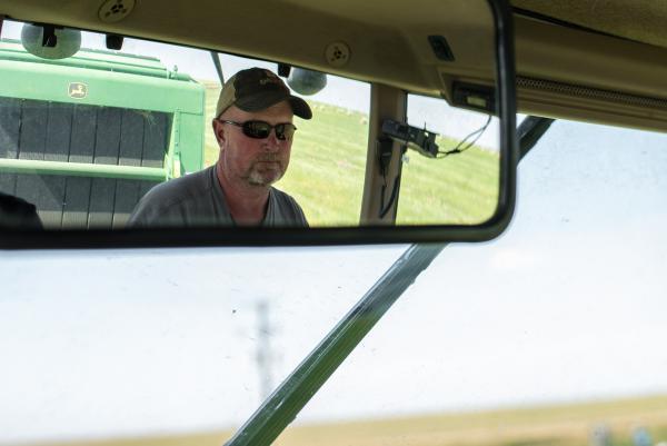 Northeast Montana farmer Dean Nelson bales a field of teff grass during an August 2019 visit.