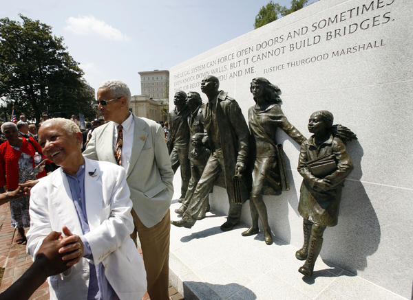Poet Nikki Giovanni, left, and NAACP chairman, Julian Bond, second from left, greet spectators as they look over the Virginia Civil Rights Memorial on the grounds of the State Capitol in Richmond, Va., Monday, July 21, 2008.