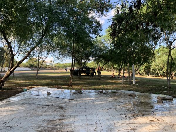 A small area in a park near the international bridge in Matamoros, Mexico where the pop-up shower tents and clean water are provided for asylum seekers.