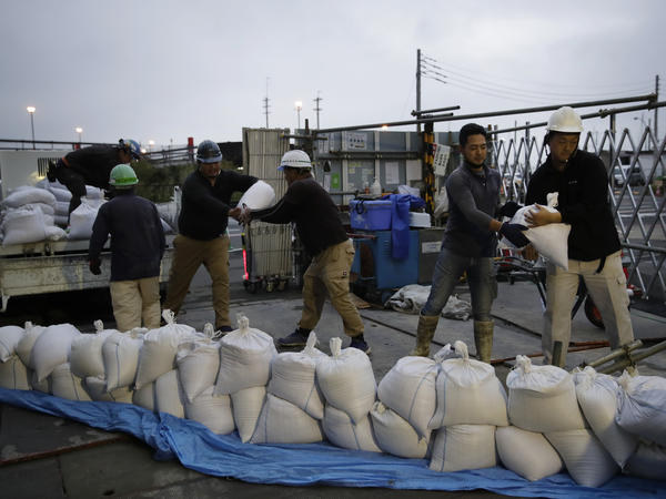 Workers stack sandbags at a construction site in preparation for Typhoon Hagibis on Enoshima Island, Kamakura, west of Tokyo on Friday. (AP Photo/Jae C. Hong)