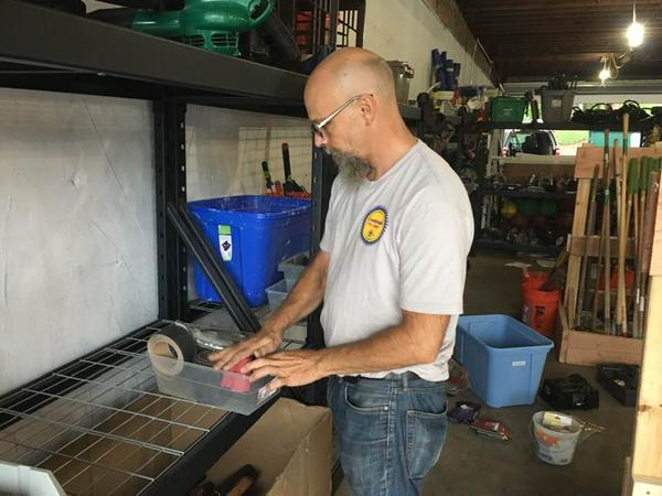 Andrew Iannaconne helps keep things in order at the tool library.