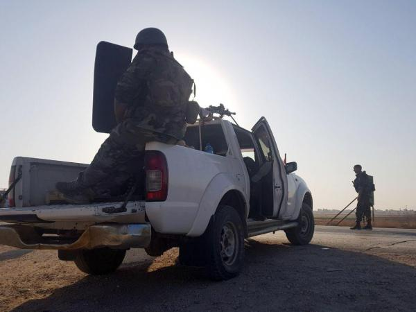 Syrian troops deployed in northern Syria, where they are now aligned with Kurdish forces that are concerned about a Turkish offensive.