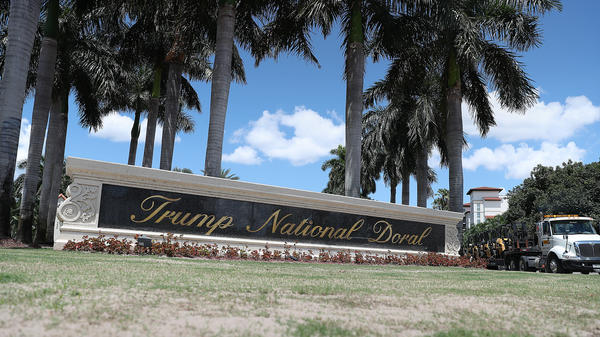 The entrance to the Trump National Doral golf resort just outside of Miami. President Trump's continued ownership and promotion of his resorts while serving in office has been controversial and is the subject of multiple investigations and lawsuits.