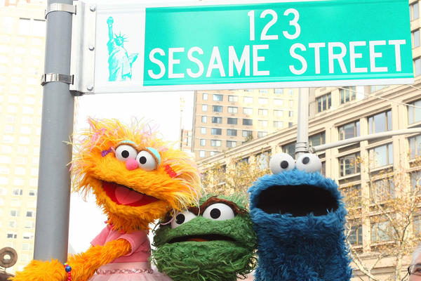 """Sesame Street characters pose under a """"123 Sesame Street"""" sign at the """"Sesame Street"""" 40th Anniversary temporary street renaming in Dante Park on Nov. 9, 2009 in New York City. (Astrid Stawiarz/Getty Images)"""