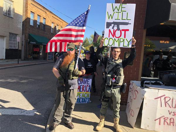 Protesters including gun rights groups are in downtown Westerville for the Democratic debate at Otterbein University on Tuesday, October 15, 2019.