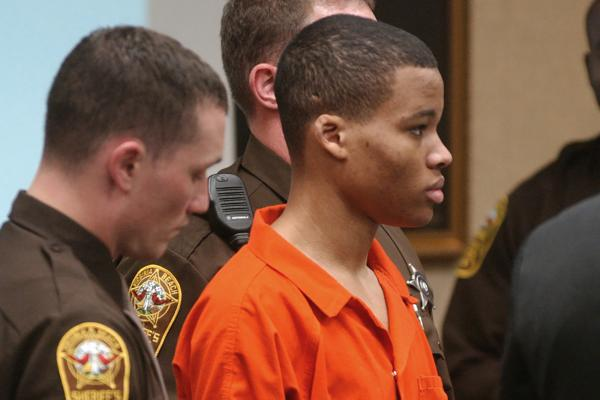 In this Oct. 20, 2003 file photo, Lee Boyd Malvo listens to court proceedings during the trial of fellow sniper suspect John Allen Muhammad in Virginia Beach, Va. An attorney for Malvo, convicted as a teenager of taking part in deadly sniper attacks that terrorized the Washington area, will argue before a Maryland judge that his young client's life sentence is unconstitutional and should be thrown out. (Martin Smith-Rodden, Pool, File/AP)