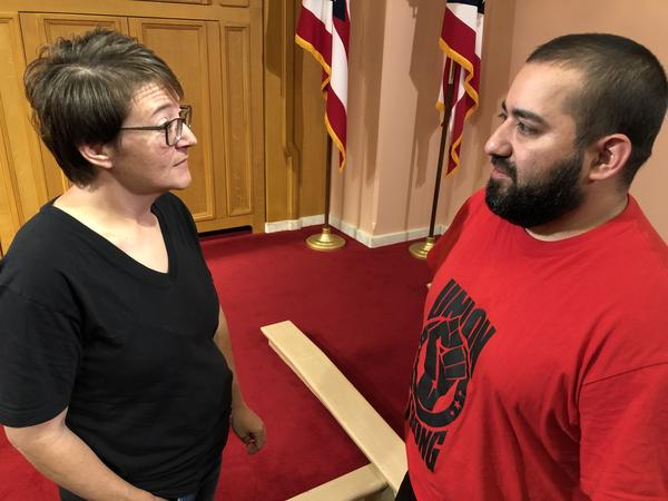 Sheri Baker (left) talks with fellow UAW member Isaac Valle (right)
