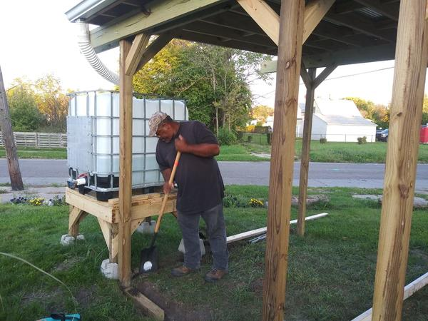 Mark Covington working on a shed in the community garden. This is just one of several upgrades he's working on.