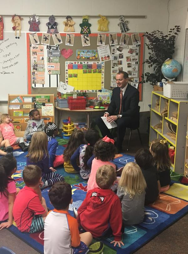 Akron Municipal Court Judge Jon Oldham talks with children at the Mandel Early Childhood Center at the Shaw JCC of Akron.