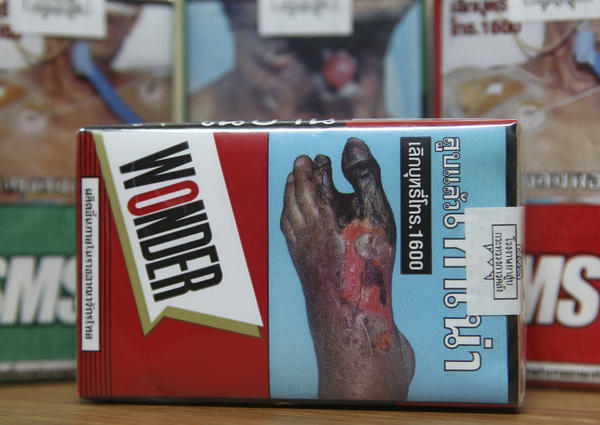 This notice on a cigarette packet in Thailand shows the potential impact of reduced blood circulation to extremities because of smoking. Such pictorial warnings are among the anti-smoking measures that are more likely to be found in countries that have limited Big Tobacco's influence on their politics, according to the new Global Tobacco Industry Interference Index.