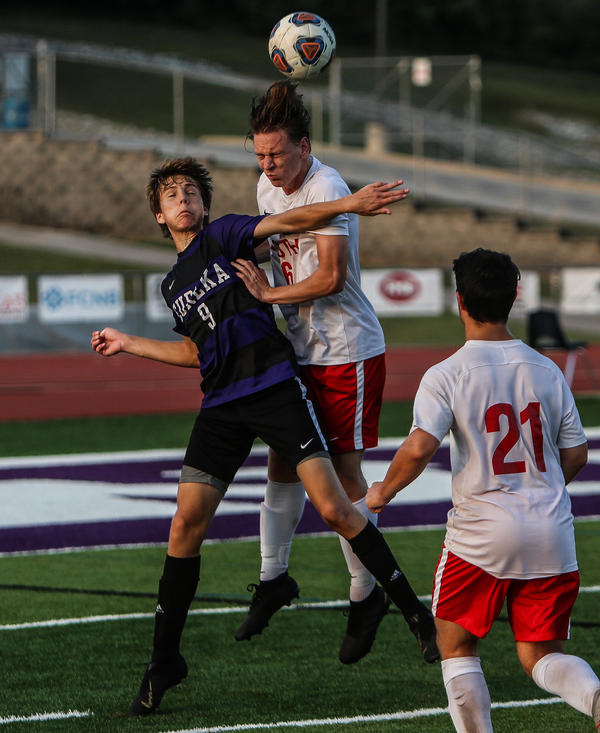 BEST ACTION SHOT - A Eureka High School varsity soccer player (left) bumps heads with a Fort Zumwalt South varsity soccer player after battling to get the ball in the air during the teams' matchup, Sept. 18.