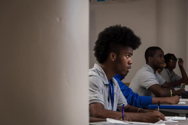 Students take notes during a social studies class at KIPP St. Louis High School in 2017.