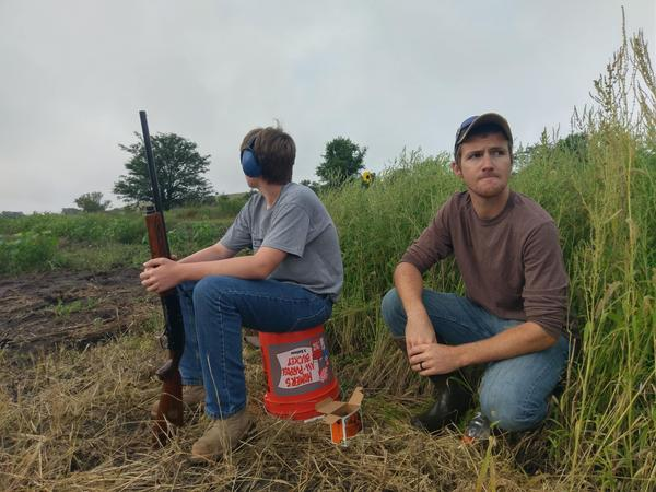 Justin Saathoff (right) leads a youth dove hunting event in September at the Jeffrey Energy Center near St. Marys, Kansas.