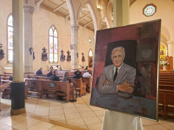 A portrait of Emilio Nicolas greeted mourners.