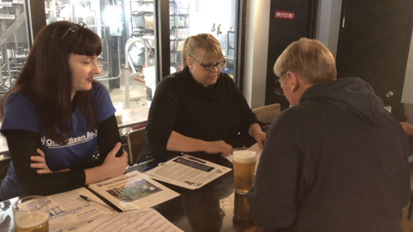 Rachael Belz, Ohio Citizen Action, collects signatures for the HB6 Referendum at Land Grant Brewery. This was one of several public events the referendum group held to collect signatures.