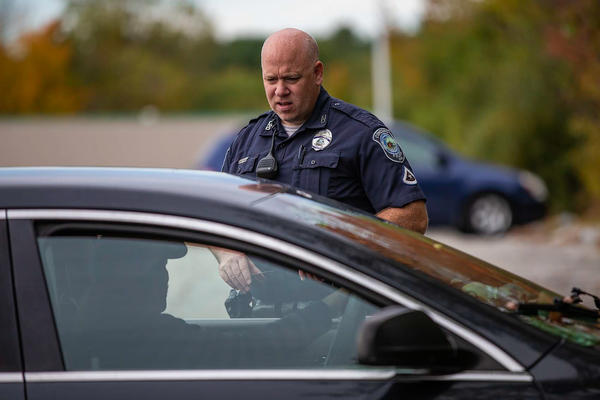 Officer Brian Cregg checks in with a man who says he is homeless and living in his car in Concord, N.H. In Concord, as in many parts of the Northeast, widespread use of meth is new, police say, and is changing how they approach interactions with people who seem to be delusional.