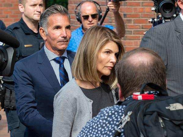 Actress Lori Loughlin and husband Mossimo Giannulli exit the Boston federal courthouse after a hearing on August 27.
