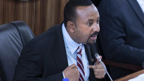 Ethiopian Prime Minister Abiy Ahmed, seen addressing lawmakers Tuesday, won a Nobel Peace Prize less than two weeks ago — but he now appears embroiled in a standoff with the activist who helped bring down the regime before him.
