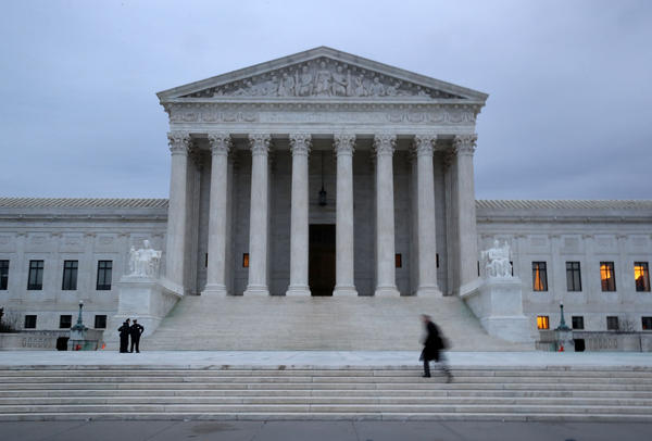 A man walks up the steps of the U.S. Supreme Court.