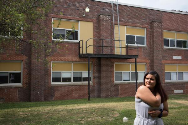 Yuliana Quintana, 19, stands outside DePue High School. DePue Community Unit School District 103 has only about half the money the district needs to provide students an adequate education.