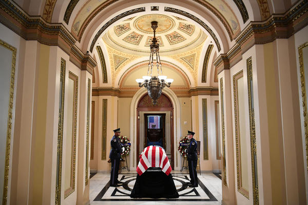 """The flag-draped casket of Rep. Elijah Cummings, D-Md., is seen at chamber doors in the Will Rogers Corridor as the late congressman is prepared to lie in state during a memorial service at the Statuary Hall of the U.S. Capitol on Thursday in Washington, D.C. Cummings passed away on Oct. 17 at age 68 from """"complications concerning longstanding health challenges,"""" according to his office."""
