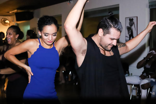 Juliana Paiva (left) and Hugo Trejo (right) dance at Convergence Dance and Body Center.