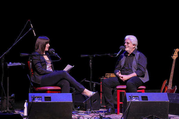 Host Ophira Eisenberg with Michael McDonald on <em>Ask Me Another</em> at the Lobero Theatre in Santa Barbara, California.