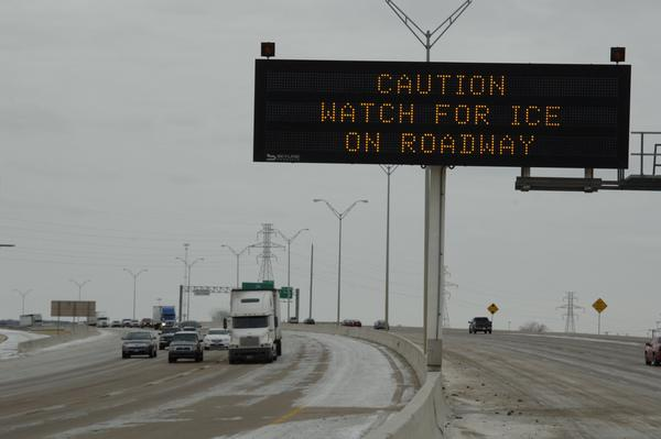Roads and schools are being closed due to snow in the Texas Panhandle as a cold front moves across the state.