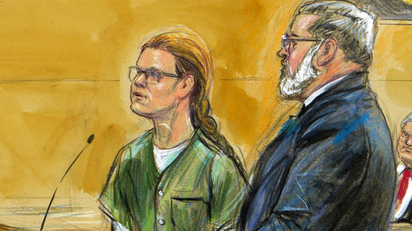 Maria Butina, seen in this courtroom sketch, stands beside her attorney Robert Driscoll during a court hearing late last year in Washington, D.C. The Russian woman has been released from prison after serving a sentence for conspiracy.