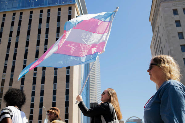 Protesters marched through downtown St. Louis on Sunday to protest ongoing U.S. Supreme Court cases that could leave LGBTQ workers in Missouri with few laws protecting them against discrimination.