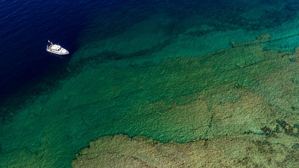 Researchers on the Great Lakes Environmental Research Laboratory's R/V Storm study sinkholes in northern Lake Huron off the coast of Alpena, Michigan.