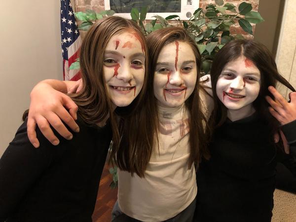 From left, Elena Flansburg, Morgan Lentz, Saralynn De La Cruz, enjoy scaring patrons of Haunted Palouse.