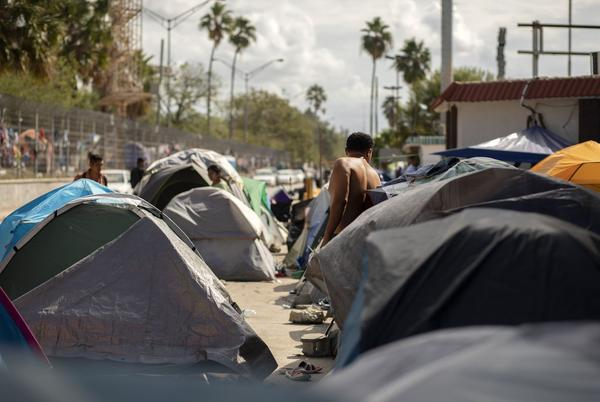 Rows of tents are clustered near the Gateway International Bridge in Matamoros, Mexico.