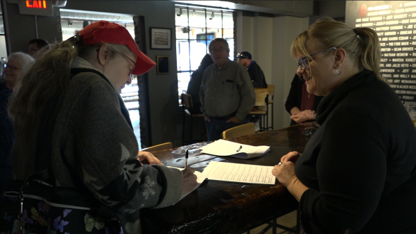 HB6 Referendum petitioners collect signatures at Land Grant Brewing.