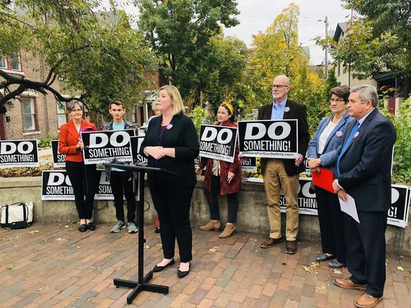 Dayton Mayor Nan Whaley, joined by County Auditor Karl Keith, State Senator Peggy Lehner, and representatives from the advocacy group Ohioans for Gun Safety.